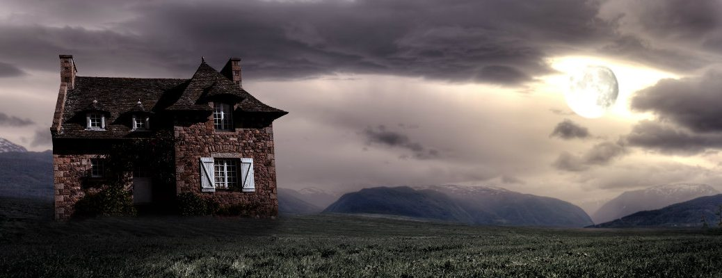 Dark and Haunted House at Twilight with full moon