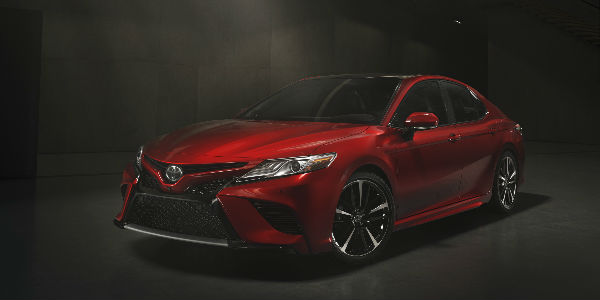 Red 2018 Toyota Camry Front And Side Exterior In Dark Area