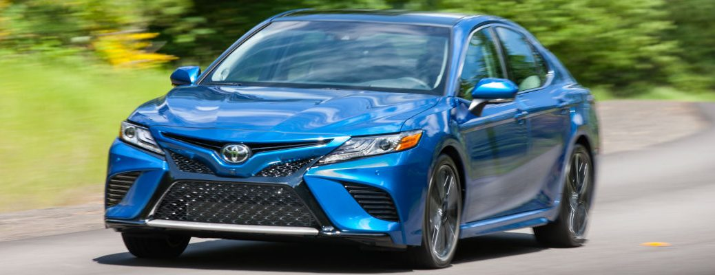 Blue 2018 Toyota Camry In Motion On Country Road