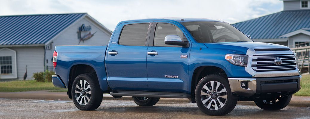 Blazing Blue Pearl 2018 Toyota Tundra in Front of Marina