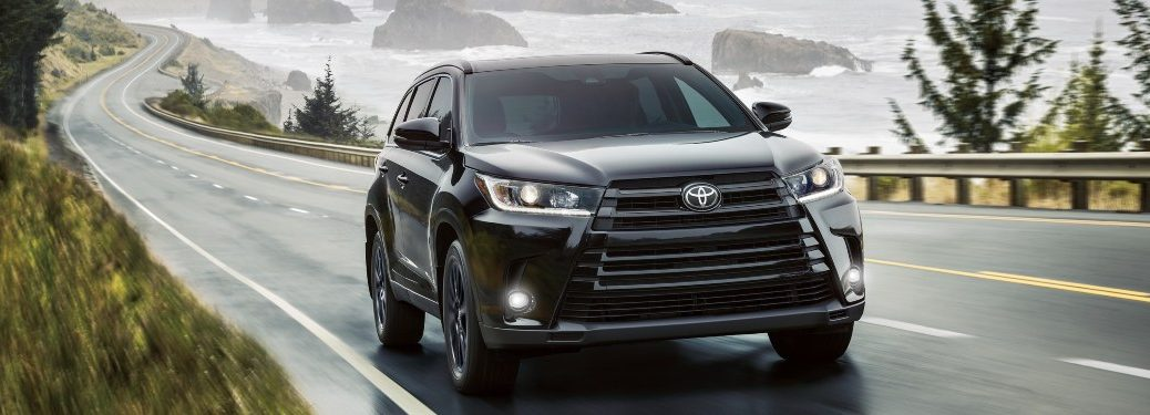 2019 Toyota Highlander driving down a rural road