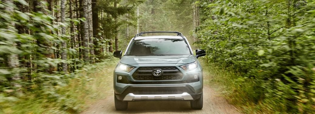 2020 Toyota RAV4 driving down a forest trail