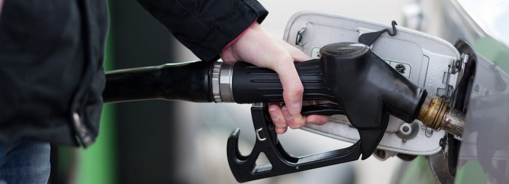 Close up on a person's hand refueling their vehicle