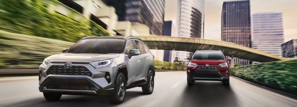 Two 2020 Toyota RAV4 models driving down a city road