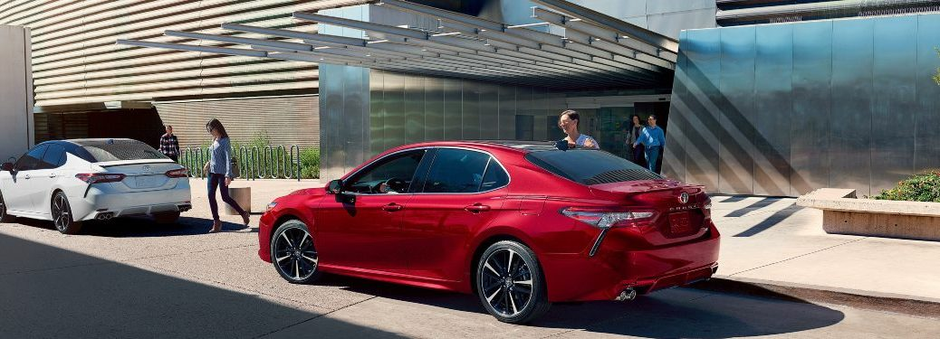 2020 Toyota Camry models parked in front of a building