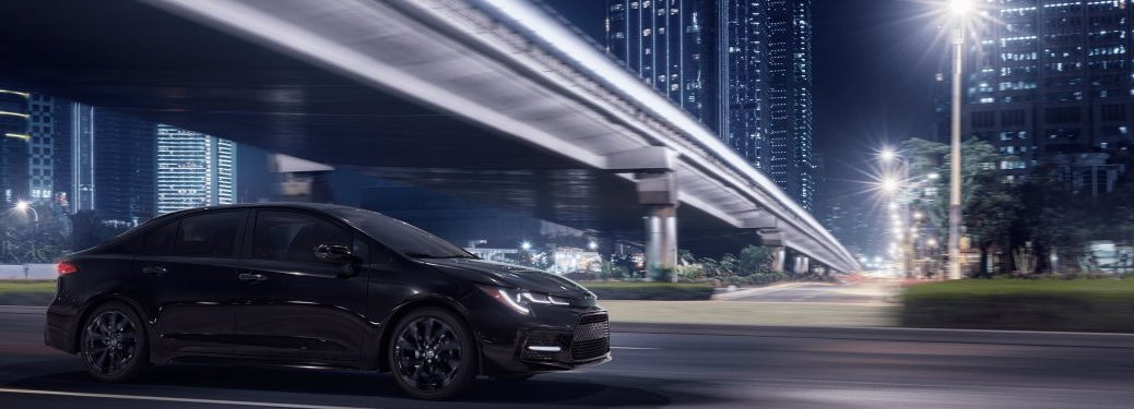 2020 Toyota Corolla driving down a street at night
