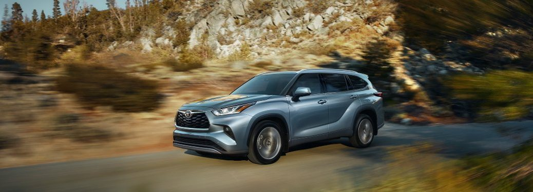 2020 Toyota Highlander driving down a rural road