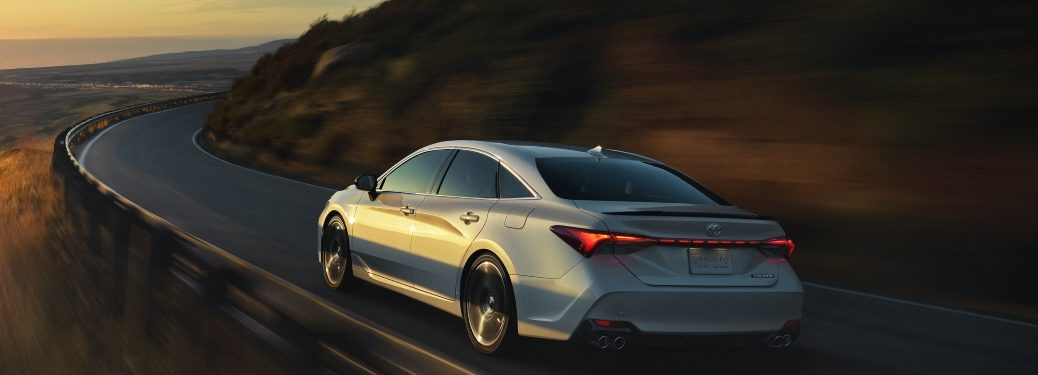 2020 Toyota Avalon driving down a mountain road