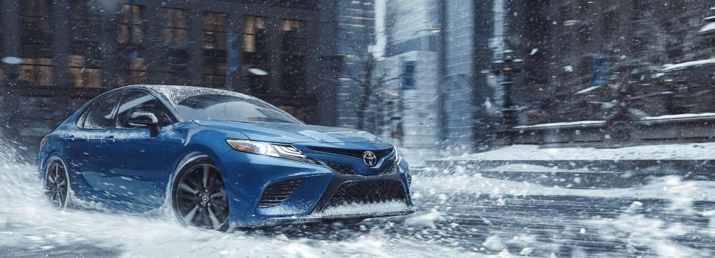 A 2020 Toyota Camry driving through a winter storm