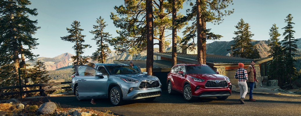 Two 2021 Toyota Highlander models parked in a parking lot