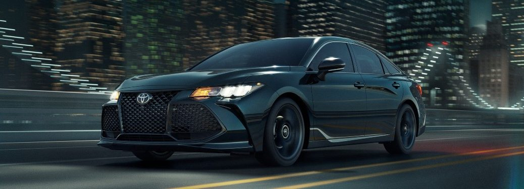 2021 Toyota Avalon driving down a city street