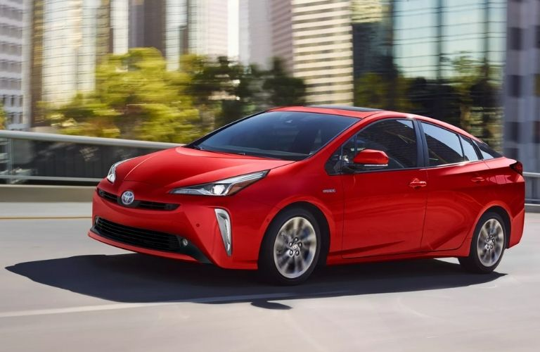 Side view of the red 2022 Toyota Prius