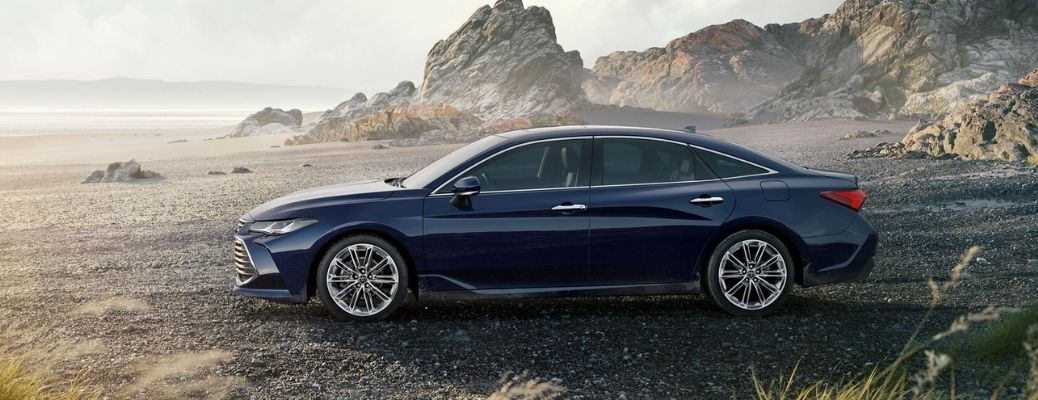 Sideview of a blue 2021 Toyota Avalon. What is the fuel economy rating?