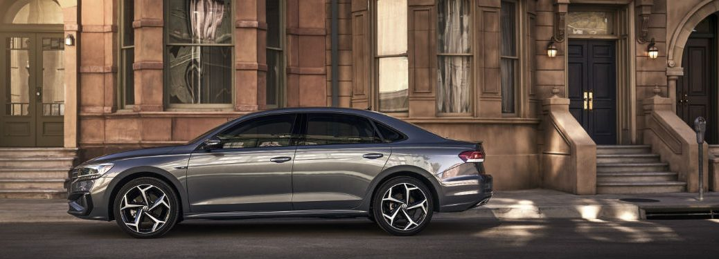 2020 VW Passat exterior drivers side profile in front of building