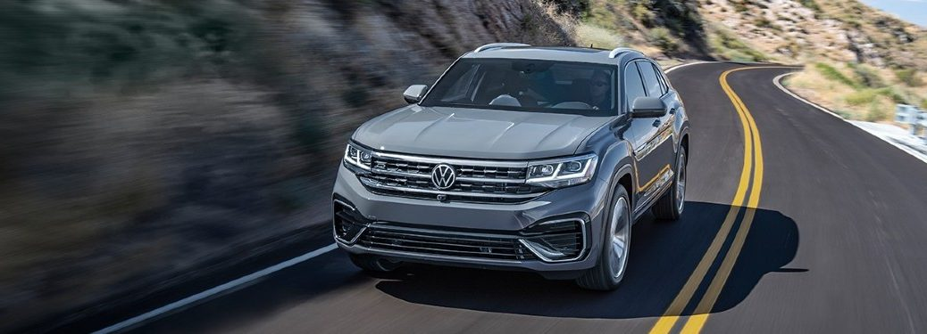 Front driver angle of a grey 2020 Volkswagen Atlas Cross Sport driving on a road