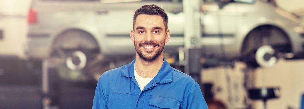Smiling mechanic in an auto shop