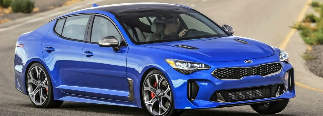 2018 Kia Stinger blue turning a corner on the track