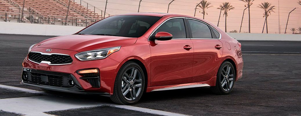 Profile shot of red 2019 Kia Forte parked on track