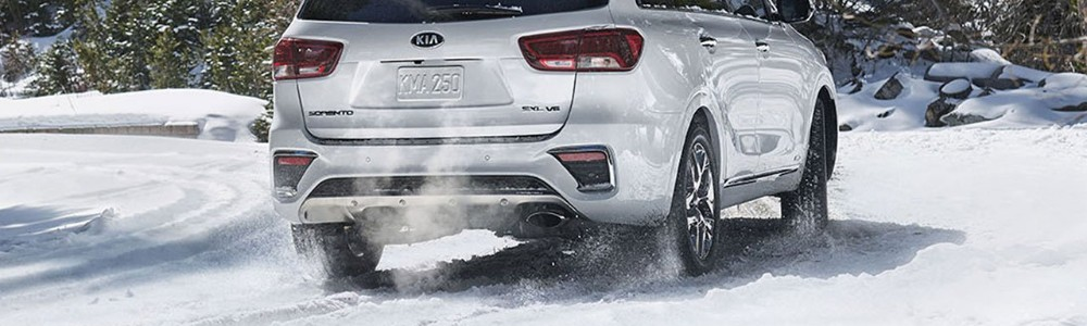 Rear shot of 2019 Kia Sorento driving through snow