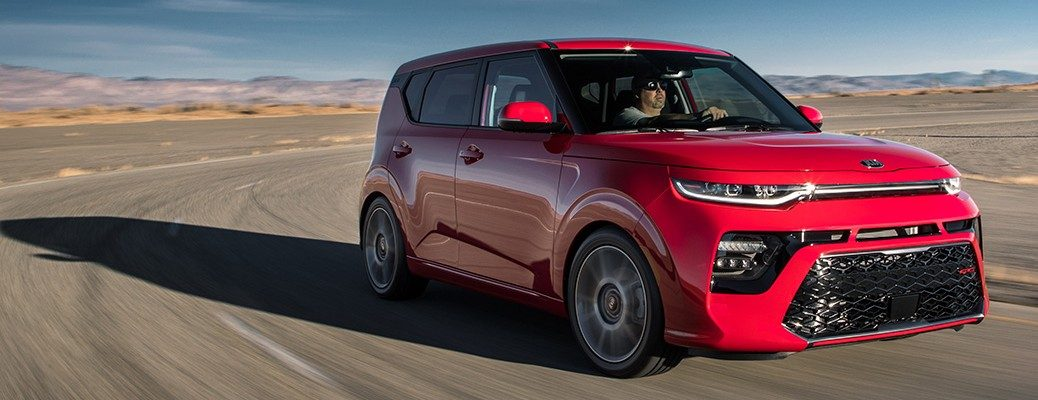 Red 2020 Kia Soul driving on empty desert road