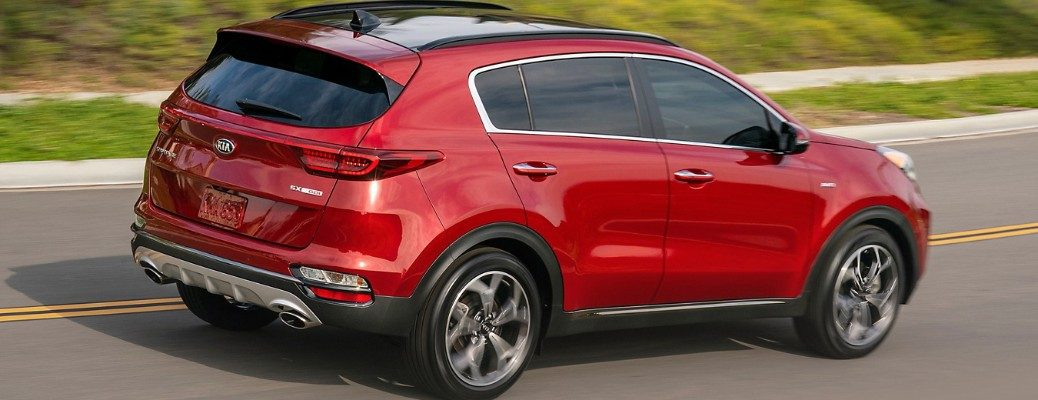 Profile view of 2020 Kia Sportage driving on residential road