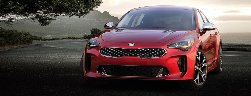 2021 Kia Stinger in a red color driving on a road