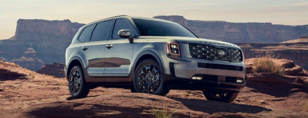 2021 Kia Telluride parked on dit path with stone structures in the background