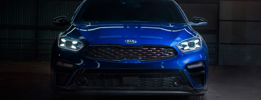 The 2021 Kia Forte in a blue color as seen from the front exterior