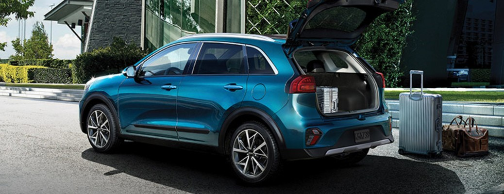 A blue-colored 2021 Kia Niro with the trunk open
