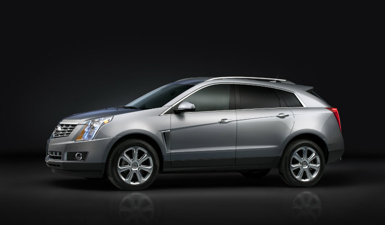 2016 Cadillac SRX crossover SUV against a black background