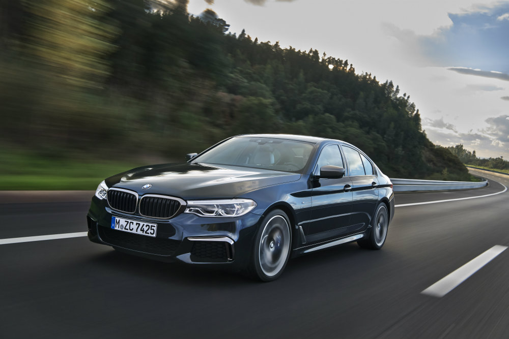 front view of the 2017 BMW M550i on the road