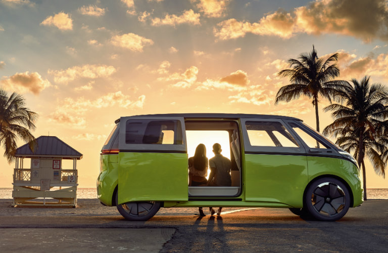 side view of the Volkswagen I.D. Buzz Concept in front of a sunset