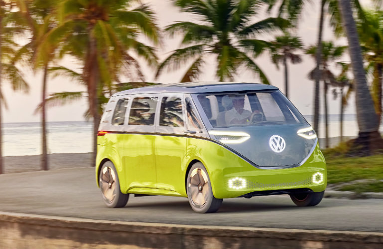 Volkswagen I.D. Buzz Concept driving among palm trees
