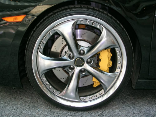 wheel and tire close-up with large yellow brake