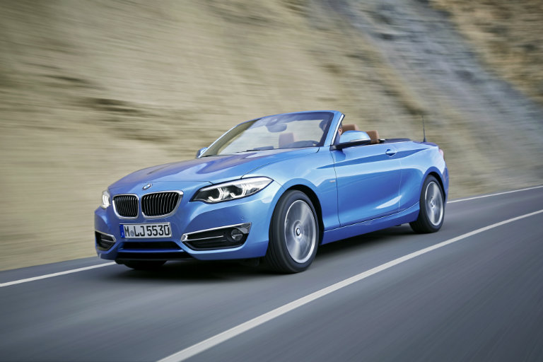 2018 BMW 2 Series Convertible driving on a curvy road