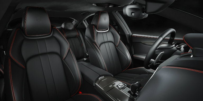 interior shot of the black seats of the 2017 Maserati Ghibli Nerissimo with red accent stitching