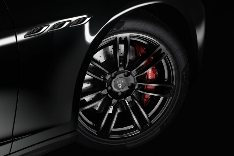 close-up of a black wheel and bright red brake on the 2017 Maserati Ghibli Nerissimo