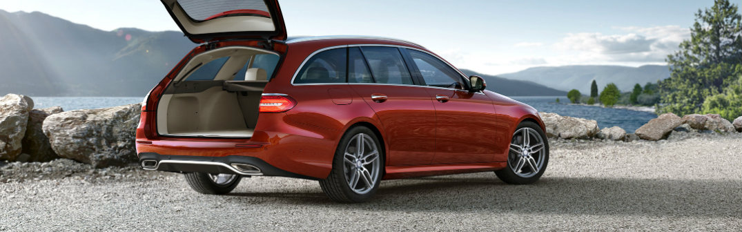 red 2017 Mercedes-Benz E-Class Wagon with the rear door open