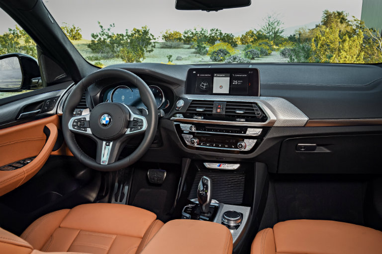 steering wheel and dashboard view of the 2018 BMW X3
