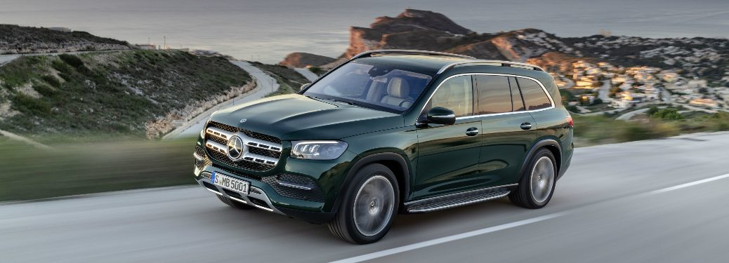 Green 2020 Mercedes-Benz GLS driving on a hilly road