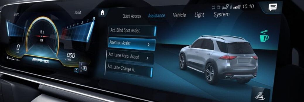 touchscreen display inside a Mercedes-Benz showing the Attention Assist system and other options