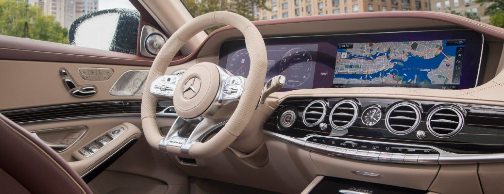 A photo of the driver's cockpit in a Mercedes-Benz sedan.