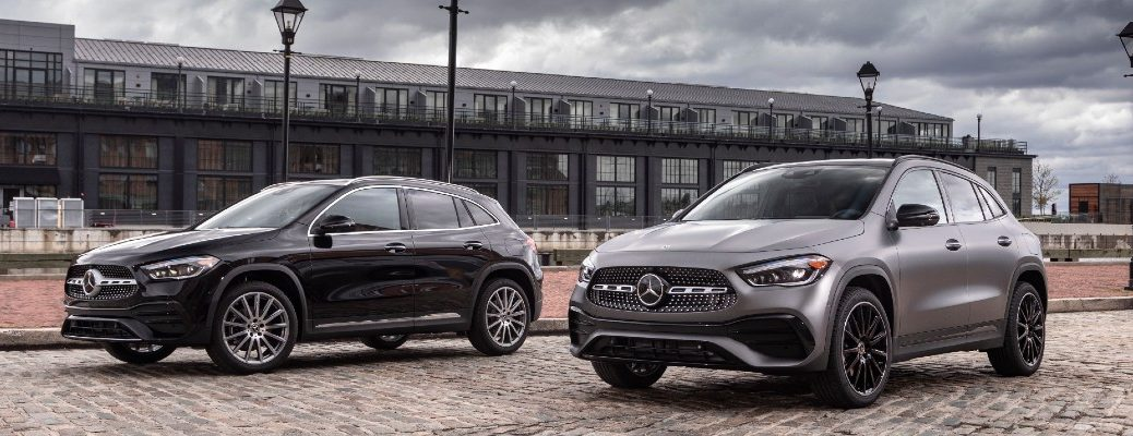 A photo of the two 2021 Mercedes-Benz GLA SUV models parked side-by-side.