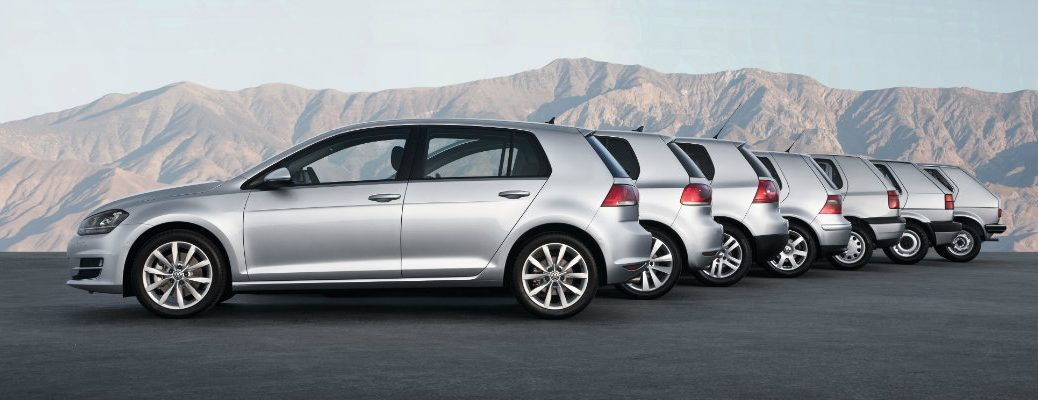 A lineup of Volkswagen Golf models generation 1 to 7 from 1975 to 2019