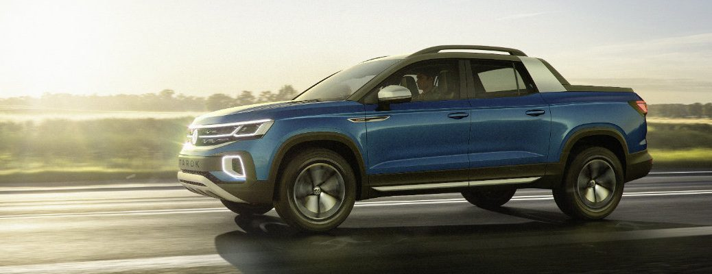 Volkswagen Tarok Pickup Truck Concept exterior side shot with blue paint color driving down a country highway as the sun rises
