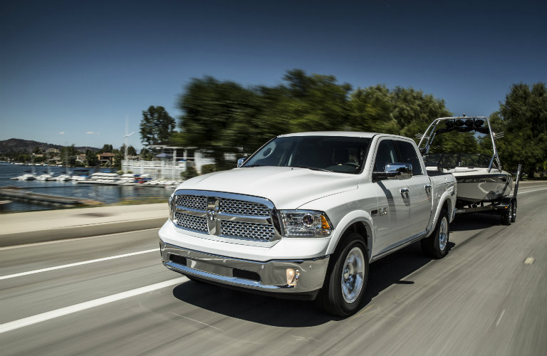 white ram 1500 pulling a boat