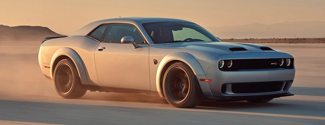 2019 Dodge Challenger SRT Hellcat driving on sandy desert road
