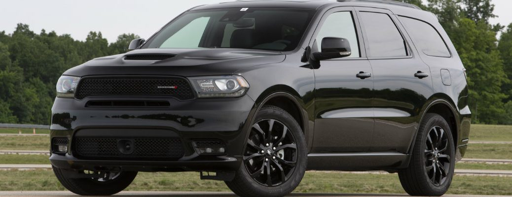 Blacked out 2019 Dodge Durango driving on country road