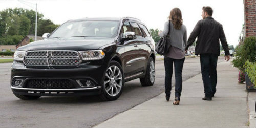 Two people walking towards 2019 Dodge Durango Citadel