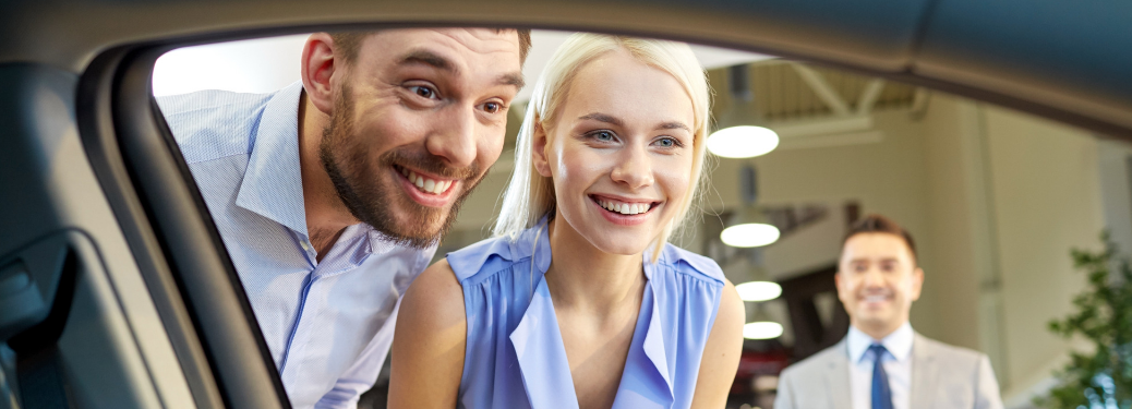 couple looking into car window